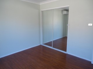 View profile: Laminate Timber Flooring throughout & Air Conditioning to all Bedrooms