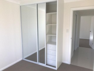 View profile: Air Conditioning & Mirrored Built in Robes